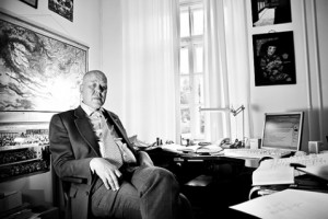 Prof. Juha Janhunen seated in his office